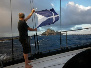 Minister of Transport Martin Legof holding the Lostislandic Flag in front of Hunter Island.